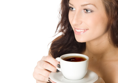 Young woman with a cup of hot drink, isolated on white