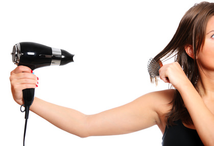Woman and a hair dryer