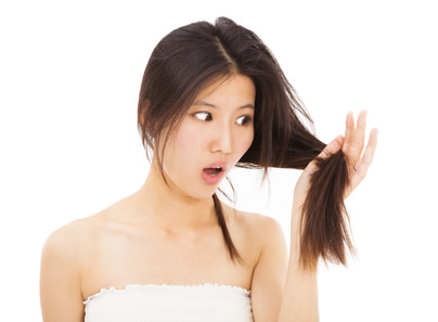 shocked woman watching the damage hair and splitting ends