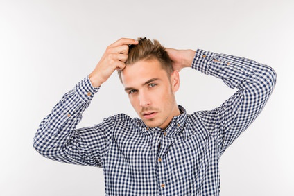 handsome young man brushing his hair