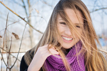 Gorgeous happy young woman winter portrait outdoors