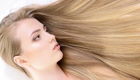 Hair. Beautiful bond girl with healthy long hair. Haicare and ha